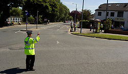 Dozens of local business were evacuated when a pressurised gass cannister caught fire in a business unit Just off Butterthwait Lane, in Ecclesfield Sheffield South Yorkshire, on Tuesday Afternoon.  Green lane was closed to traffic from the Traffic lights at the junction of Green lane and Ecclefield Common through to the junction of Green lane and  Grange Lane - A police officer direct traffic at the junction of Green lane and ecclesfield Common<br /> <br /> 02 June 2009 Copyright Paul David Drabble