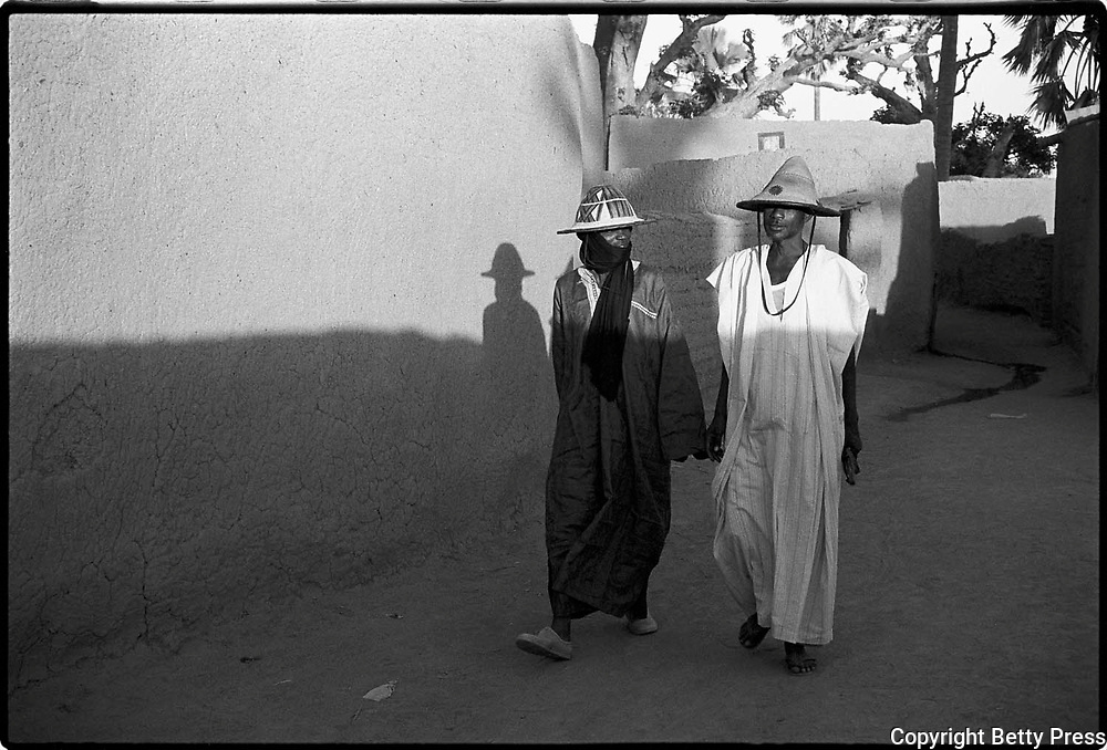 If you want to walk fast, walk alone; if you want to walk far, walk with others.  Zimbabwean proverb  <br /> <br /> These elders were returning to their homes  after celebrating one of the important festivals for the Peul people, the Crossing of the Cattle. Diafarabé, Mali. 1994