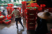 While still a British colony, a 1990s market shallholder drags a load of vegetable items in baskets in the New Territories, on 21st April 1995, in Hong Kong, China. (Photo by Richard Baker / In Pictures via Getty Images)