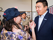 22 JANUARY 2020 - CHARLES CITY, IOWA: ANDREW YANG shakes hands with a woman after speaking at a campaign event in the public library in Charles City, IA. Yang, an entrepreneur, is running for the Democratic nomination for the US Presidency in 2020. He is in northern Iowa as a part of his 17 day bus tour across the state. Iowa hosts the the first election event of the presidential election cycle. The Iowa Caucuses will be on Feb. 3, 2020.        PHOTO BY JACK KURTZ