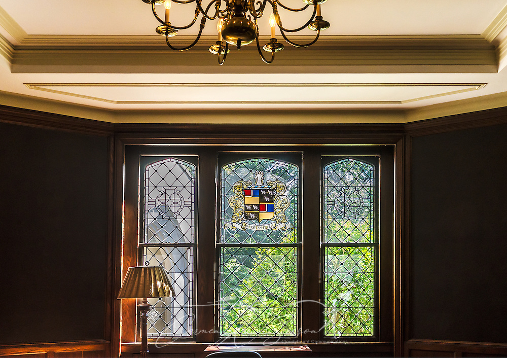 A stained glass window features a family crest at Callanwolde Fine Arts Center, which is housed within a 27,000 square foot Gothic-Tudor Revival mansion and  nestled on 12 acres in Atlanta, Georgia. The house, built in 1920, was the home of Charles Howard Candler, son of the founder of the Coca-Cola Company. The house was designed by architect Henry Hornbostel. Today, Callanwolde operates as a non-profit organization devoted to teaching and promoting the visual, literary and performing arts. (Photo by Carmen K. Sisson/Cloudybright)