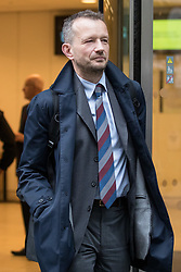 © Licensed to London News Pictures. 12/04/2018. London, UK. Jonathan Munro, Head of Newsgathering at the BBC leaves the Rolls Building at the Royal Courts of Justice, following the trial in legal battle between Sir Cliff Richard and the BBC. The performer is suing the BBC after it broadcast pictures and named Sir Cliff as a suspect in an alleged historical sexual assault. Photo credit : Tom Nicholson/LNP