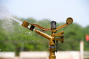 Farm irrigation a close-up of a water sprinkler