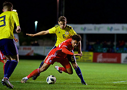 RHYL, WALES - Wednesday, November 14, 2018: Wales' Christian Norton goes down in the box under pressure from  Scotland's Robbie Deas during the UEFA Under-19 Championship 2019 Qualifying Group 4 match between Wales and Scotland at Belle Vue. (Pic by Paul Greenwood/Propaganda)
