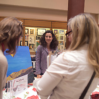 Executive Director of gallupARTS Rose Eason discusses upcoming events at Art123 during the Women's Resource Fair and Open-mic Read-out held Wednesday at University of New Mexico Gallup campus and sponsored by the Zollinger Library.
