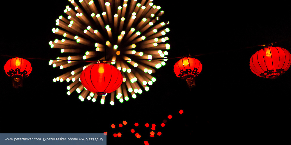 Fireworks explode behind a group of red lanterns at the conclusion of Aucklands 2012 Lantern Festival.