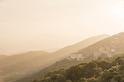 View of town in mountains at summer sunset, Sartene, Corsica, France