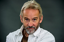 Pictured: Jasper FForde<br /> <br /> Jasper Fforde (born 11 January 1961) is a British novelist. Fforde's first novel, The Eyre Affair, was published in 2001. Fforde is known mainly for his Thursday Next novels. He has published two books in the loosely connected Nursery Crime series, and has published the first books of two additional independent series, The Last Dragonslayer and Shades of Grey.<br /> <br /> Fforde's books contain a profusion of literary allusions and wordplay, tightly scripted plots, and playfulness with the conventions of traditional genres. His works usually contain elements of metafiction, parody, and fantasy. <br /> <br /> Ger Harley | EEm 11 August 2018