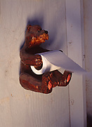 Bear toilet paper dispenser in the Bissell Family's outhouse, Chickaloon, Alaska.