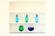 shelf<br /> with bottles and glasses colored