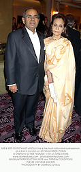 MR & MRS GOPICHAND HINDUJA he is the multi millionaire businessman, at a ball in London on 6th March 2003.PHS 46