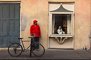Man in red shirt waiting in the street outside an art Gallery on 11th March 2020 in New Orleans, Louisiana, United States.