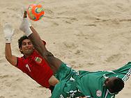 Football-FIFA Beach Soccer World Cup 2006 - Group D-Argentina - Nigeria, Beachsoccer World Cup 2006. Argentina's Marcelo Salguero and Nigeria`s Ibenegbu- Rio de Janeiro - Brazil 02/11/2006<br /> Mandatory credit: FIFA/ Manuel Queimadelos