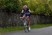 France, October 9 2011: An amateur cyclist climbs the Côte de l'Epan before the 2011 edition of the Paris Tours cycle race. Copyright 2011 Peter Horrell