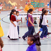 112912       Cable Hoover<br /> <br /> Codetalker Joe Vandever Sr. watches a step dance held in his honor during an assembly at Baca Community School in Prewitt Thursday.