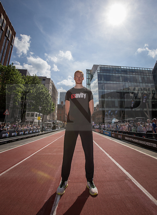 © Licensed to London News Pictures . 17/05/2014 . Manchester , UK . GREG RUTHERFORD on the running track on Deansgate . The Great City Games in Manchester , with athletics on a track along Deansgate and Pole Vault and Long Jump in Albert Square . Photo credit : Joel Goodman/LNP