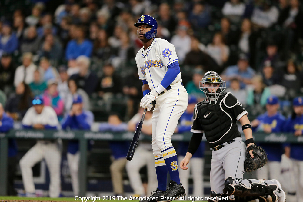 Seattle Mariners' Kyle Lewis prepares to bat against the Chicago White Sox during a baseball game, Sunday, Sept. 15, 2019, in Seattle. (AP Photo/John Froschauer)