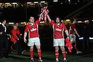 Welsh capt Gethin Jenkins (l) and Adam Jones celebrate with the trophy.  RBS Six nations championship 2013, Wales v England at the Millennium stadium in Cardiff , South Wales on Saturday 16th March 2013. pic by Andrew Orchard, Andrew Orchard sports photography,