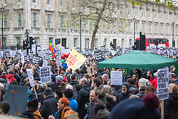 London, November 28th 2015. As Prime Minister David Cameron pushes for Parliament to vote to allow aerial strikes against Islamic State targets in Syria, Britain's Stop The War Coalition and thousands of anti-war protesters demonstrate outside Downing Street.   //// FOR LICENCING CONTACT: paul@pauldaveycreative.co.uk TEL:+44 (0) 7966 016 296 or +44 (0) 20 8969 6875. ©2015 Paul R Davey. All rights reserved.
