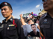 07 JULY 2015 - BANGKOK, THAILAND:  Thai police block access to people protesting the arrest and detention of 14 Thai university students. About 100 people gathered in front of the Ministry of Defense in Bangkok Tuesday to support 14 university students arrested two weeks ago for violating orders against political assembly. They're facing criminal trial in military courts. The courts ordered their release Tuesday because they can only be held for two weeks without trial, the two weeks expired Tuesday and the military court chose not to renew their pretrial detention. The court order was not an acquittal. They still face trial and possible prison sentences if convicted.       PHOTO BY JACK KURTZ