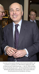 Conservative party leader IAIN DUNCAN-SMITH, at a party in London on 18th March 2002.OYI 158