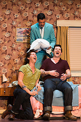 "© Licensed to London News Pictures. 14/05/2014. London, England. L-R: Randall Bills as Ferrando, Roderick Williams as Don Alfonso and Marcus Farnsworth as Guglielmo. Dress rehearsal of the Wolfgang Amadeus Mozart opera ""Così fan tutte"" at the London Coliseum. A new ENO production of Mozart's dark comedy set in the world of a 1950's Coney Island funfair. With Kate Valentine as Fiordiligi, Christine Rice as Dorabella, Marcus Farnsworth as Guglielmo, Randall Bills as Ferrando, Mary Bevan as Despina and Roderick Williams as Don Alfonso. Directed by Phelim McDermott, Conductor: Ryan Wigglesworth. Co-produced by the English National Opera and the Metropolitan Opera, New York. In collaboration with Improbable. 12 performances from 16 May to 6 July 2014. Photo credit: Bettina Strenske/LNP"