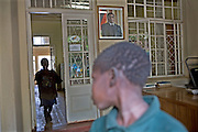 Street children walk past a picture of President Robert Mugabe on the wall of the Streets Ahead centre in Harare, Zimbabwe. Streets Ahead is a welfare organisation that works with underprivileged children living on the streets of Harare.