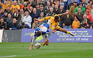 Christian Jolley of Newport is fouled by Bristol Rovers Captain Tom Parkes (l) to earn Newport a penalty . Skybet League two match, Newport county v Bristol Rovers at Rodney Parade in Newport, South Wales on Saturday 17th August 2013  . pic by Phil Rees ,Andrew Orchard sports photography,