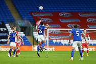 Millwall's Kenneth Zohore (13) competes for a high ball with Cardiff City's Curtis Nelson (16) during the EFL Sky Bet Championship match between Cardiff City and Millwall at the Cardiff City Stadium, Cardiff, Wales on 30 January 2021.