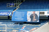 Tribute banner to QPR fan Dean McKee who died from coronavirus during the EFL Sky Bet Championship match between Queens Park Rangers and Barnsley at the Kiyan Prince Foundation Stadium, London, England on 20 June 2020.