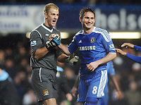 Football - Premier League - Chelsea vs. Manchester City Joe Hart (Man City goalkeeper) jokes with Penalty goal scorer Frank Lampard (Chelsea) at the final whistle.