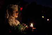 Echo the Dead is an annual procession that takes place in New Orleans every year on the 1st November - in line with the Mexican Day of the Dead, and All Saints Day. Similar to the Latino procession Dia de Las Muertas, it is a unique and little known of event that gives residents a chance to pay homage to lost loved ones. New Orleans, Louisiana, USA. walking down the street in the French Quarter,