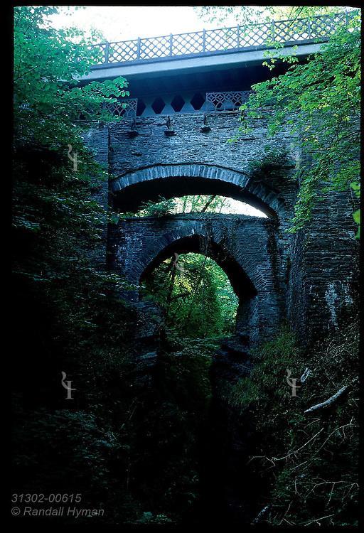 Devil's Bridge arches over waterfalls at confluence of Rheidol and Mynach rivers, with 11th & 18th century lower spans; Wales.