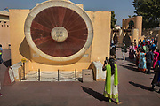 The worlds largest stone sundial in Jantar Mantar, an astronomical observation site built in the early 18th century, photographed on 4th February 2018 in Jaipur, Rajasthan, India. The Jantar Mantar is a collection of 19 astronomical instruments built by the Rajput king Sawai Jai Singh II, the founder of Jaipur, Rajasthan. The instruments allow the observation of astronomical positions with the naked eye. The observatory is an example of the Ptolemaic positional astronomy which was shared by many civilizations.The monument was completed in 1734. It is now a UNESCO World Heritage site.