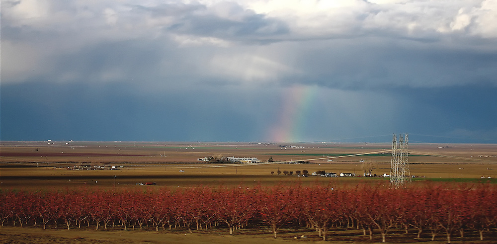 While driving through San Joaquin Valley in California, I encountered a heavy thunderstorm and then a beautiful rainbow