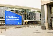 Milan, Piazza Gae Aulenti, alert banner against Corona virus
