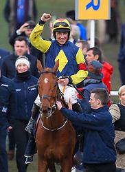 Jockey Davy Russell celebrates winning the Brown Advisory and Merriebelle Stable Plate with horse The Stroyteller during St Patrick's Thursday of the 2018 Cheltenham Festival at Cheltenham Racecourse.