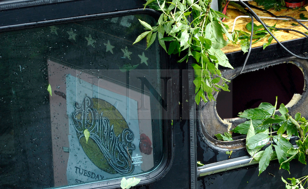 © Licensed to London News Pictures. 15/08/2012. Bath, UK. A placard with the word Baroness is visible through the window of a coach carrying an American band called Baroness crashed off the road and down a slope at Brass Knocker Hill on the A36 near Bath. The band had played in Bristol last night and were en route to Southampton.  They have now announced they have cancelled the last gig of their tour.  15 August 2012..Photo credit: Simon Chapman/LNP