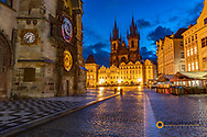 Astronomical Clock and Týn Church at dawn in Prague, Czech Republic