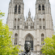King Baudouin statue in front of the Cathedral of St. Michael and St. Gudula (in French, Co-Cathédrale collégiale des Ss-Michel et Gudule). A church was founded on this site in the 11th century but the current building dates to the 13th to 15th centuries. The Roman Catholic cathedral is the venue for many state functions such as coronations, royal weddings, and state funerals. It has two patron saints, St Michael and St Gudula, both of whom are also the patron saints of Brussels.