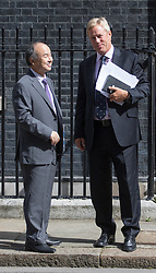 Downing Street, London, July 18th 2016. CEO of Soft Bank Masayoshi Son and Chairman Stuart Chambers of Chip maker ARM emerge from 11 Downing Street following the conclusion of a deal by Soft Bank to purchase ARM for £24 billion.