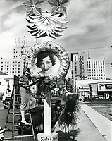 1932 Claudette Colbert by her Christmas wreath on Vine St.