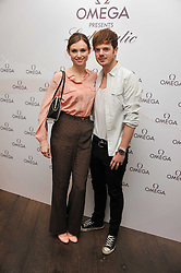 SOPHIE ELLIS-BEXTOR and RICHARD JONES at a pool party to celebrate the UK launch of the Omega Ladymatic Collection held at the Haymarket Hotel, Haymarket, London on 16th June 2011.