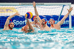 Pascal Janssen, Kjeld Veenhuis, Guus Wolswinkel of the Netherlands in action against Montenegro during the Olympic qualifying tournament. The Dutch water polo players are on the hunt for a starting ticket for the Olympic Games on February 19, 2021 in Rotterdam
