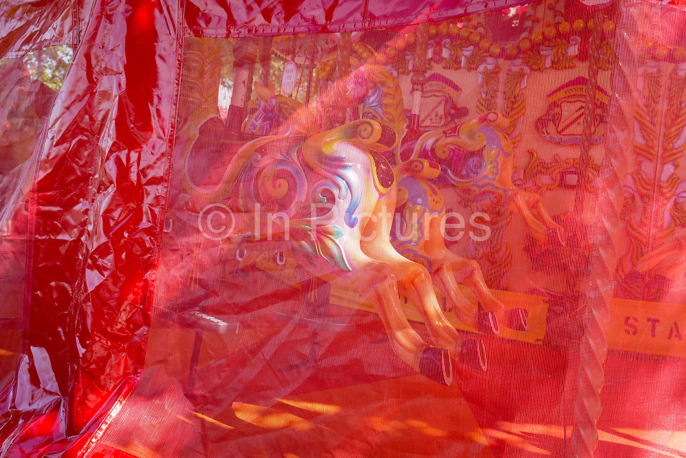 Covered fairground carousel horses on the Southbank, on 9th May 2018, in London, England.