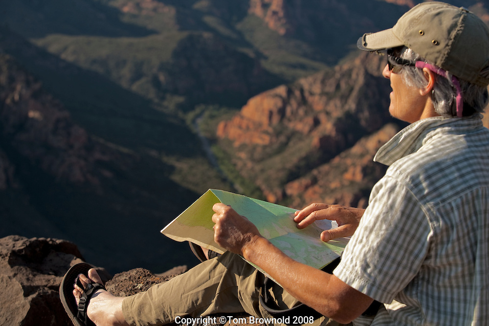 Map and compass reading on the Mogollon rim overlooking Sycamore canyon