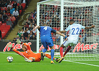 Football - 2017 / 2018 FIFA World Cup Qualifier - UEFA Group F: England vs. Slovakia<br /> <br /> Raheem Sterling of England cuts the ball back past goalkeeper Martin Dubravka of  Slovakia at Wembley Stadium.<br /> <br /> COLORSPORT/ANDREW COWIE