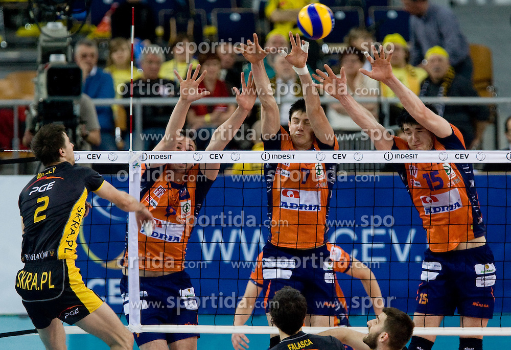 Mariusz Wlazly of Belchatow vs Dejan Vincic, Matevz Kamnik and Vid Jakopin of ACH at  match for 3rd place of CEV Indesit Champions League FINAL FOUR tournament between PGE Skra Belchatow, POL and ACH Volley Bled, SLO on May 2, 2010, at Arena Atlas, Lodz, Poland.  (Photo by Vid Ponikvar / Sportida)