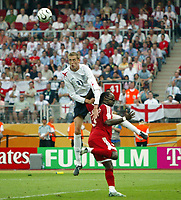 Photo: Chris Ratcliffe.<br /> England v Trinidad & Tobago. Group B, FIFA World Cup 2006. 15/06/2006.<br /> Peter Crouch from England climbs above Brent Sancho of T & T scoring the first goal.