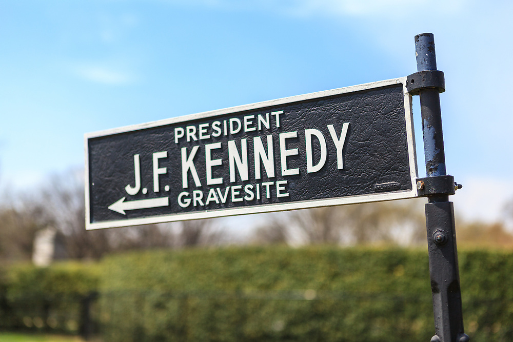 Washington, DC, USA - April 11, 2013: President Kennedy gravesite directional sign at the Arlington National Cemetery.